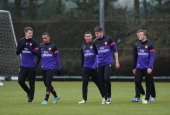 Aaron Ramsey Theo Walcott Alex OxladeChamberlain Carl Jenkinson Kieran Gibbs and Jack Wilshere of Arsenal during a training session at London Colney...