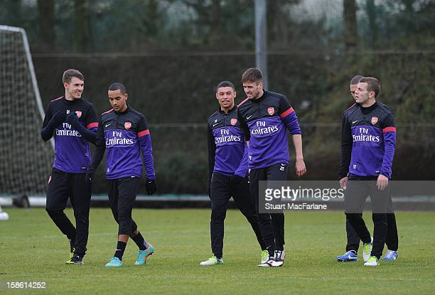Aaron Ramsey Theo Walcott Alex OxladeChamberlain Carl Jenkinson Kieran Gibbs and Jack Wilshere of Arsenal during a training session at London Colney...