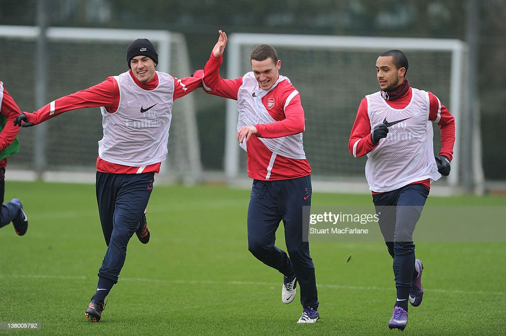 Aaron Ramsey Thomas Vermaelen and Theo Walcott of Arsenal in action during a training session at London Colney on January 31 2012 in St Albans England