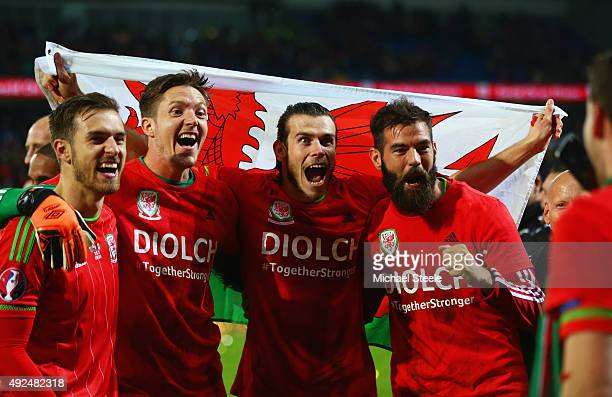 Aaron Ramsey Wayne Hennessey Gareth Bale and Joe Ledley of Wales celebrate victory after the UEFA EURO 2016 qualifying Group B match between Wales...