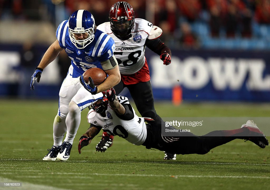 Aaron Roberson #30 of the Cincinnati Bearcats dives for Brandon Connette #18 of the Duke Blue Devils during their game at Bank of America Stadium on December 27, 2012 in Charlotte, North Carolina.