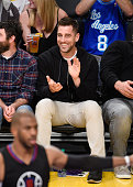 Aaron Rodgers attends a basketball game between the Los Angeles Clippers and the Los Angeles Lakers at Staples Center on April 6 2016 in Los Angeles...