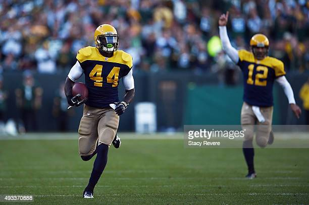 Aaron Rodgers celebrates as James Starks of the Green Bay Packers runs for a touchdown during a game against the San Diego Chargers at Lambeau Field...