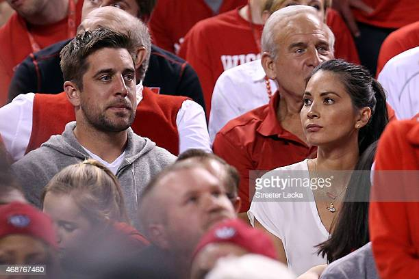 Aaron Rodgers of the Green Bay Packers and actress Olivia Munn look on during the game between the Wisconsin Badgers and the Duke Blue Devils during...