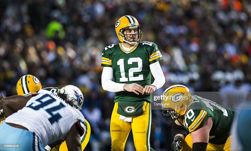 <a gi-track='captionPersonalityLinkClicked' href=/galleries/search?phrase=Aaron+Rodgers+-+American+Football+Quarterback&family=editorial&specificpeople=215257 ng-click='$event.stopPropagation()'>Aaron Rodgers</a> #12 of the Green Bay Packers audibles against the Tennessee Titans at Lambeau Field on December 23, 2012 in Green Bay, Wisconsin.