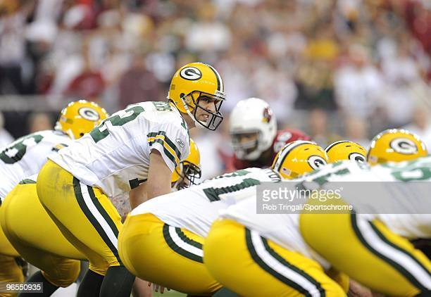Aaron Rodgers of the Green Bay Packers before the snap against the Arizona Cardinals in the NFC wildcard playoff game at University of Phoenix...