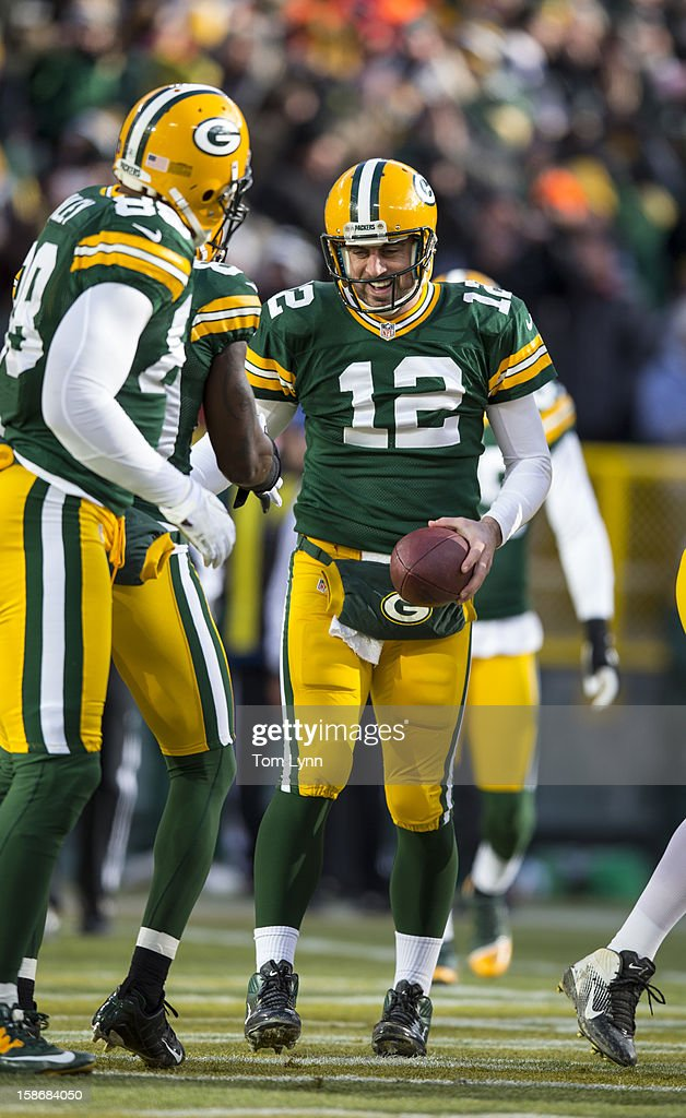 <a gi-track='captionPersonalityLinkClicked' href=/galleries/search?phrase=Aaron+Rodgers+-+American+Football+Quarterback&family=editorial&specificpeople=215257 ng-click='$event.stopPropagation()'>Aaron Rodgers</a> #12 of the Green Bay Packers celebrates a touchdown against the Tennessee Titans at Lambeau Field on December 23, 2012 in Green Bay, Wisconsin.