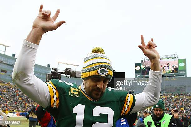 Aaron Rodgers of the Green Bay Packers celebrates after defeating the Dallas Cowboys 2621 during the 2015 NFC Divisional Playoff game at Lambeau...