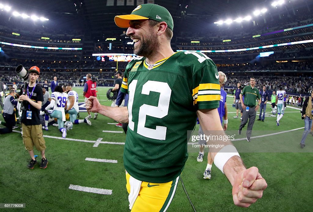 Aaron Rodgers #12 of the Green Bay Packers celebrates after Mason Crosby #2 of the Green Bay Packers kicked the game winning field goal against the Dallas Cowboys in the final seconds of a NFC Divisional Playoff game at AT&T Stadium on January 15, 2017 in Arlington, Texas. The Green Bay Packers beat the Dallas Cowboys 34-31