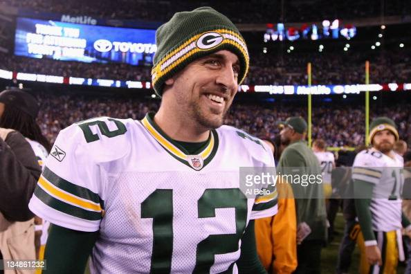 Aaron Rodgers of the Green Bay Packers celebrates after the Packers won 3835 against the New York Giants at MetLife Stadium on December 4 2011 in...