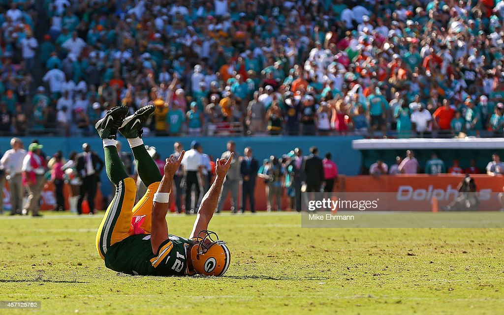 Aaron Rodgers of the Green Bay Packers celebrates the winning touchdown during a game against the Miami Dolphins at Sun Life Stadium on October 12...