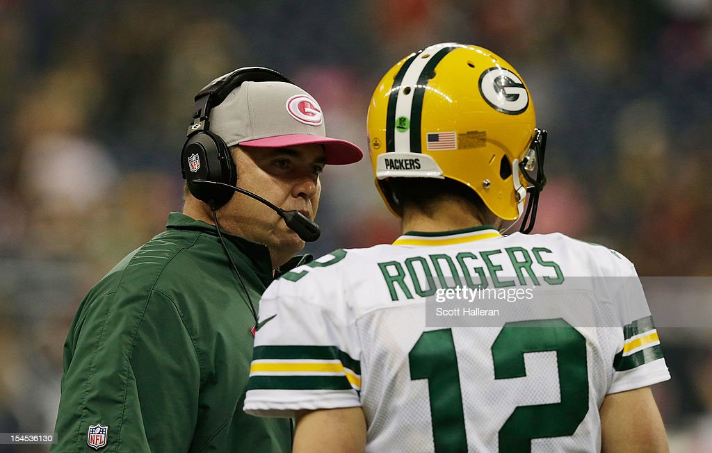 <a gi-track='captionPersonalityLinkClicked' href=/galleries/search?phrase=Aaron+Rodgers+-+American+Football+Quarterback&family=editorial&specificpeople=215257 ng-click='$event.stopPropagation()'>Aaron Rodgers</a> #12 of the Green Bay Packers (R) chats with his head coach <a gi-track='captionPersonalityLinkClicked' href=/galleries/search?phrase=Mike+McCarthy+-+American+Football+Coach&family=editorial&specificpeople=639233 ng-click='$event.stopPropagation()'>Mike McCarthy</a> near the bench in the fourth quarter against the Houston Texans at Reliant Stadium at Reliant Stadium on October 14, 2012 in Houston, Texas.