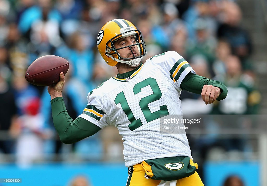 Aaron Rodgers of the Green Bay Packers drops back to pass against the Carolina Panthers during their game at Bank of America Stadium on November 8...