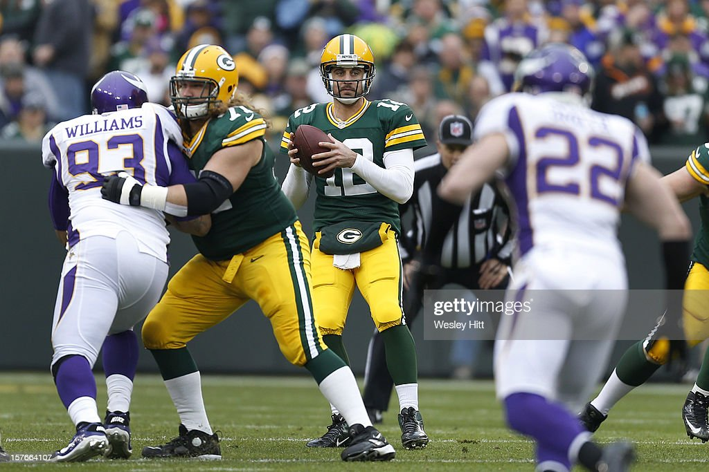 Aaron Rodgers #12 of the Green Bay Packers drops back to pass during a game against the Minnesota Vikings at Lambeau Field on December 2, 2012 in Green Bay, Wisconsin. The Packers defeated the Vikings 23-14.