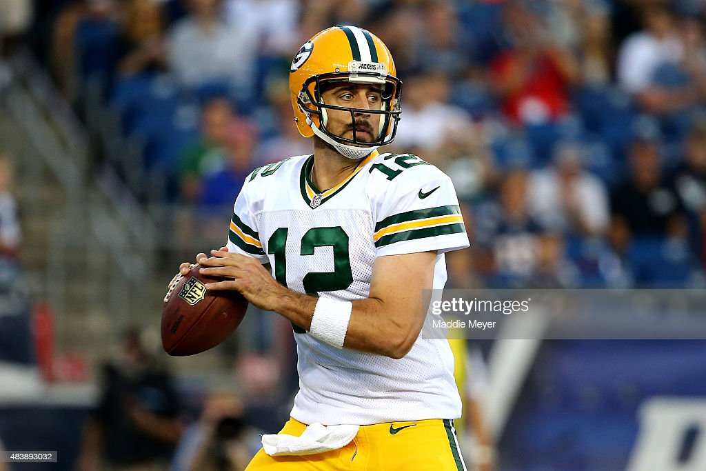 Aaron Rodgers #12 of the Green Bay Packers drops back to pass in the first quarter against the New England Patriots during a preseason game at Gillette Stadium on August 13, 2015 in Foxboro, Massachusetts.