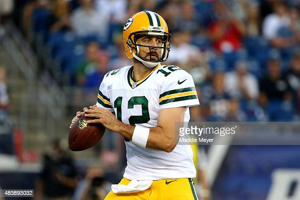 Aaron Rodgers of the Green Bay Packers drops back to pass in the first quarter against the New England Patriots during a preseason game at Gillette...