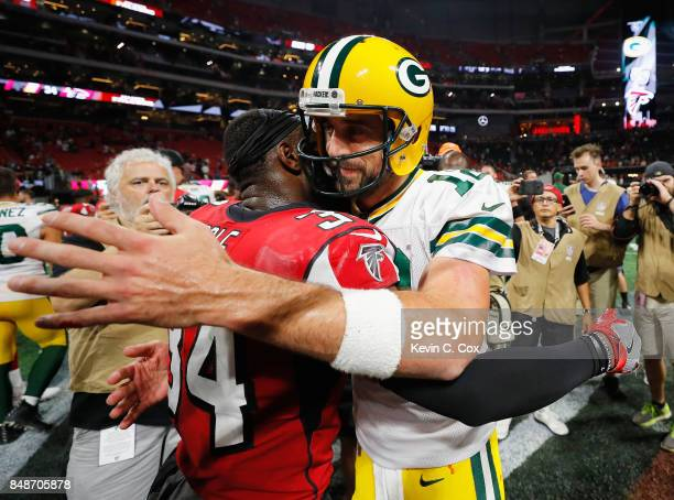 Aaron Rodgers of the Green Bay Packers hugs Brian Poole of the Atlanta Falcons after the Falcons defeated the Packers 3423 at MercedesBenz Stadium on...
