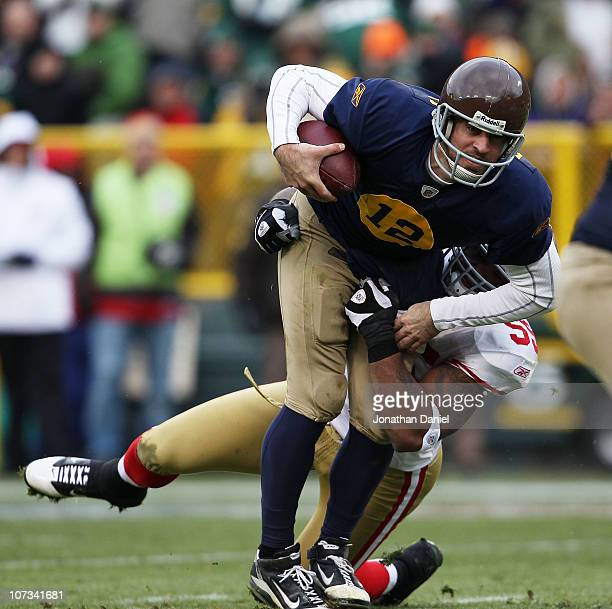 Aaron Rodgers of the Green Bay Packers is sacked by Ahmad Brooks of the San Francisco 49ers at Lambeau Field on December 5 2010 in Green Bay...