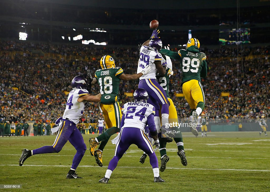 Aaron Rodgers #12 of the Green Bay Packers is unable to complete a hail mary pass during the fourth quarter against the Minnesota Vikings at Lambeau Field on January 3, 2016 in Green Bay, Wisconsin.