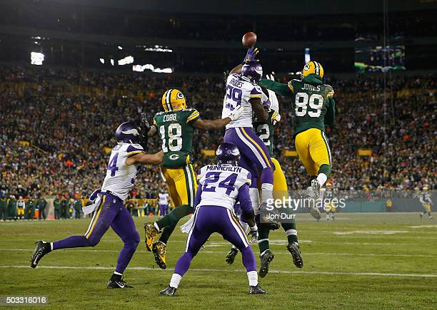 Aaron Rodgers of the Green Bay Packers is unable to complete a hail mary pass during the fourth quarter against the Minnesota Vikings at Lambeau...