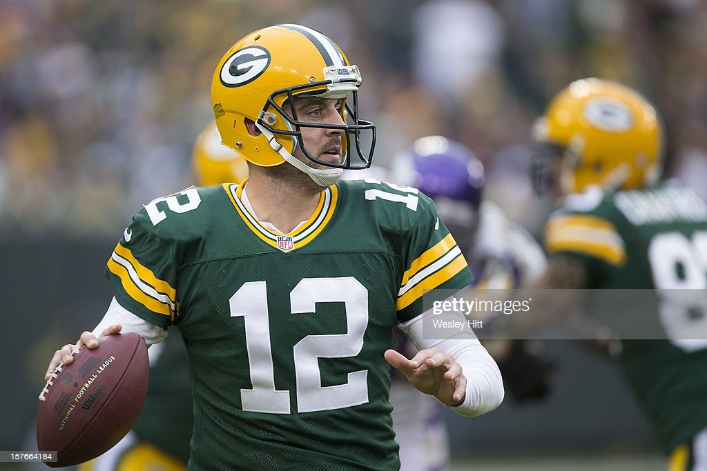 Aaron Rodgers #12 of the Green Bay Packers looks for a open receiver during a game against the Minnesota Vikings at Lambeau Field on December 2, 2012 in Green Bay, Wisconsin. The Packers defeated the Vikings 23-14.