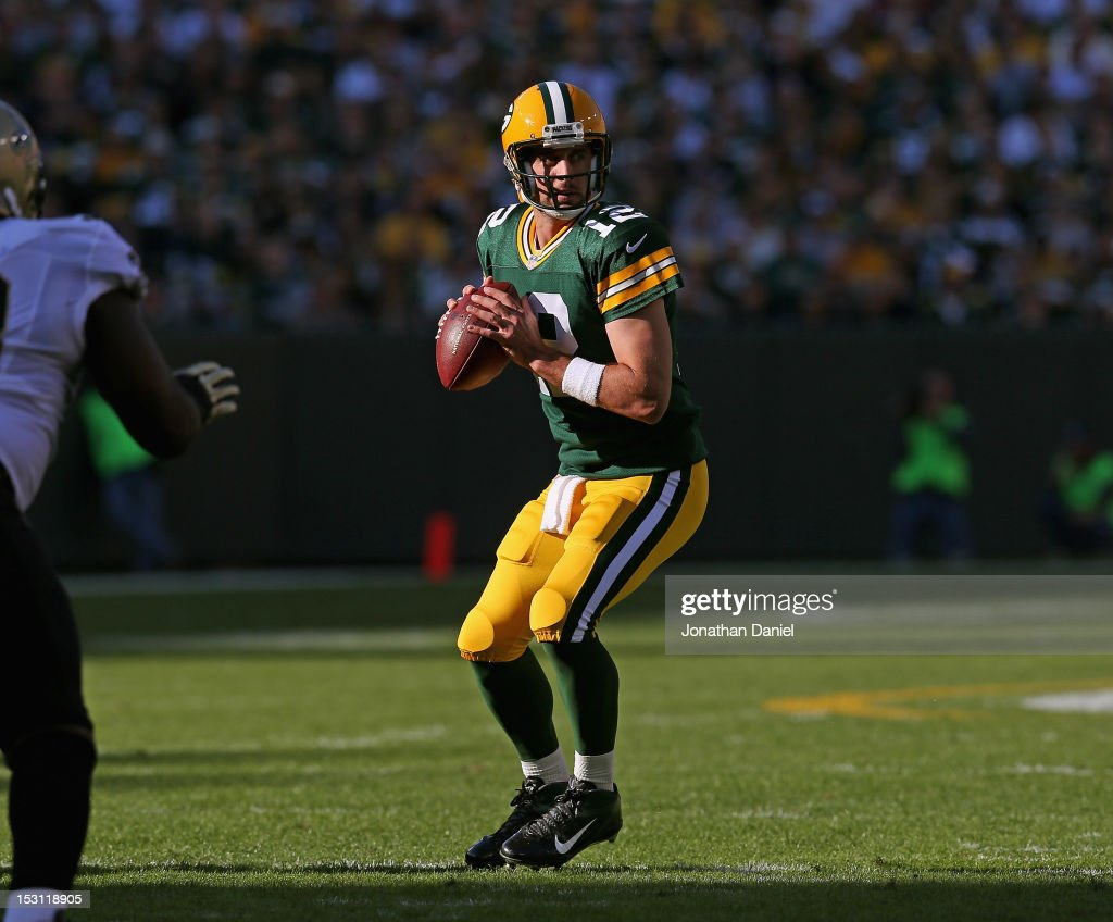 Aaron Rodgers #12 of the Green Bay Packers looks for a receiver against the New Orleans Saints at Lambeau Field on September 30, 2012 in Green Bay, Wisconsin.