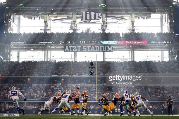 Aaron Rodgers of the Green Bay Packers looks for an open receiver in the third quarter against the Dallas Cowboys at ATT Stadium on October 8 2017 in...