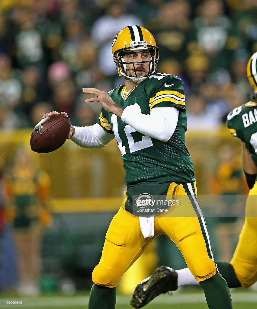 <a gi-track='captionPersonalityLinkClicked' href=/galleries/search?phrase=Aaron+Rodgers+-+American+Football+Quarterback&family=editorial&specificpeople=215257 ng-click='$event.stopPropagation()'>Aaron Rodgers</a> #12 of the Green Bay Packers looks or a receiver against the Chicago Bears at Lambeau Field on November 4, 2013 in Green Bay, Wisconsin. The Bears defeated the Packers 27-20.