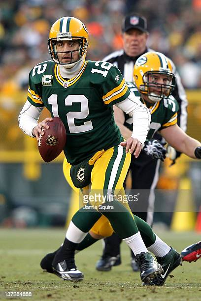 Aaron Rodgers of the Green Bay Packers looks to pass against the New York Giants during their NFC Divisional playoff game at Lambeau Field on January...