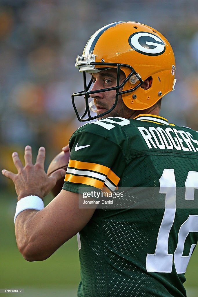 Aaron Rodgers #12 of the Green Bay Packers participates in warm-ups before a game against the Arizona Cardinals at Lambeau Field on August 9, 2013 in Green Bay, Wisconsin.