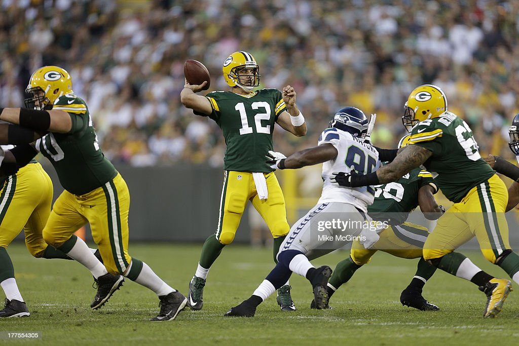 Aaron Rodgers #12 of the Green Bay Packers passes against the Seattle Seahawks during the game at Lambeau Field on August 23, 2013 in Green Bay, Wisconsin.