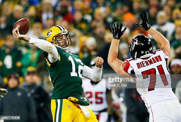 Aaron Rodgers of the Green Bay Packers passes under pressure from Kroy Biermann of the Atlanta Falcons in the second half at Lambeau Field on...