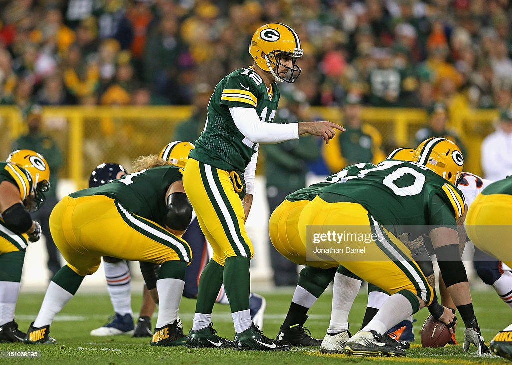 <a gi-track='captionPersonalityLinkClicked' href=/galleries/search?phrase=Aaron+Rodgers+-+American+Football+Quarterback&family=editorial&specificpeople=215257 ng-click='$event.stopPropagation()'>Aaron Rodgers</a> #12 of the Green Bay Packers points out a Chicago Bears defensive formation at Lambeau Field on November 4, 2013 in Green Bay, Wisconsin. The Bears defeated the Packers 27-20.