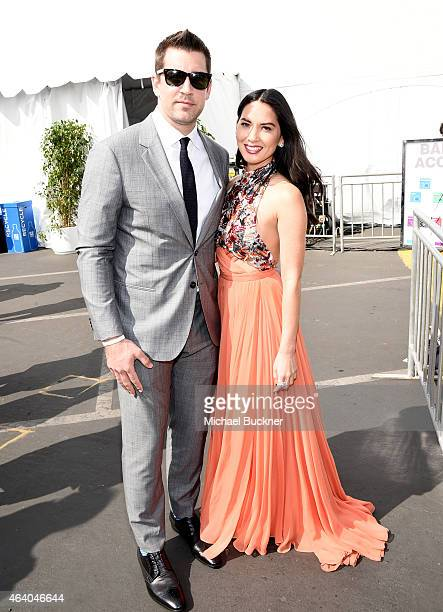Aaron Rodgers of the Green Bay Packers poses with actress Olivia Munn with FIJI Water during the 30th Annual Film Independent Spirit Awards at Santa...
