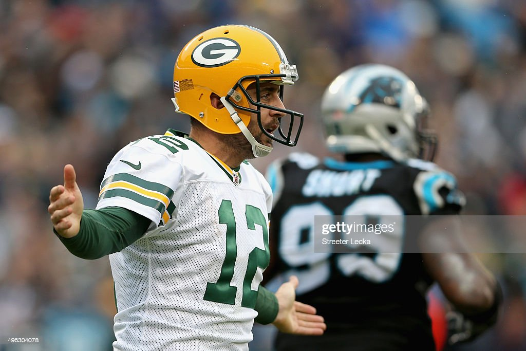 Aaron Rodgers #12 of the Green Bay Packers questions a call in the 3rd quarter against the Carolina Panthers during their game at Bank of America Stadium on November 8, 2015 in Charlotte, North Carolina.