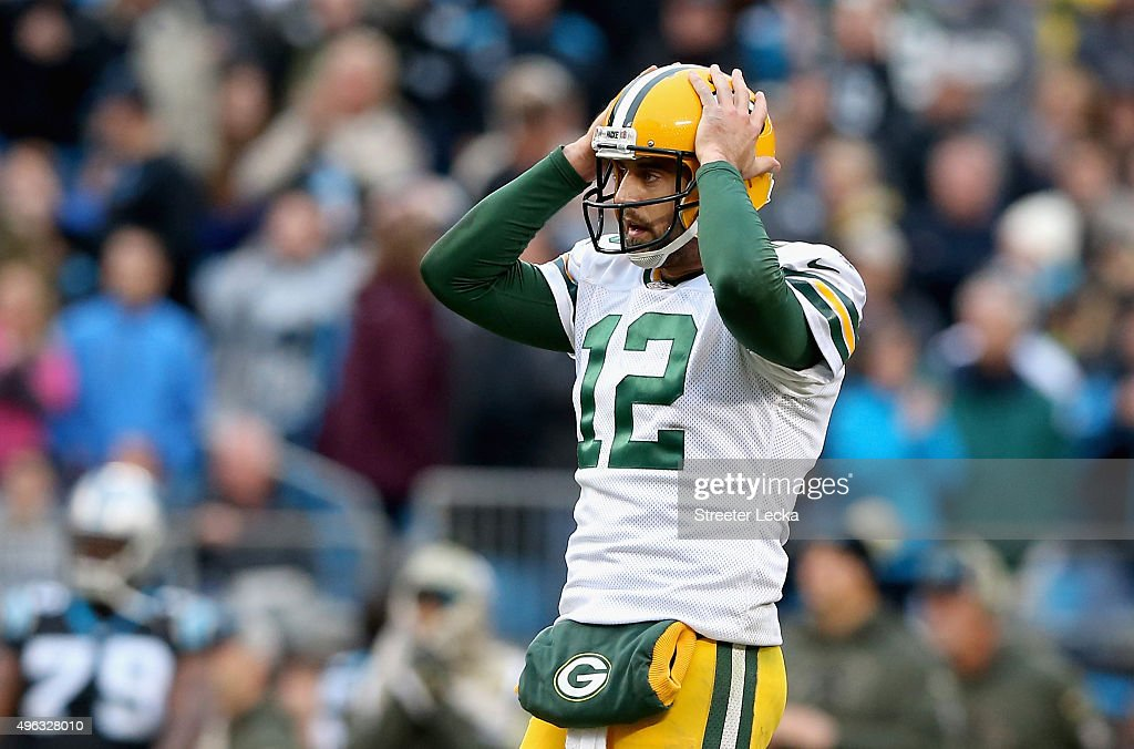Aaron Rodgers #12 of the Green Bay Packers reacts after a pass during their game against the Carolina Panthers at Bank of America Stadium on November 8, 2015 in Charlotte, North Carolina.