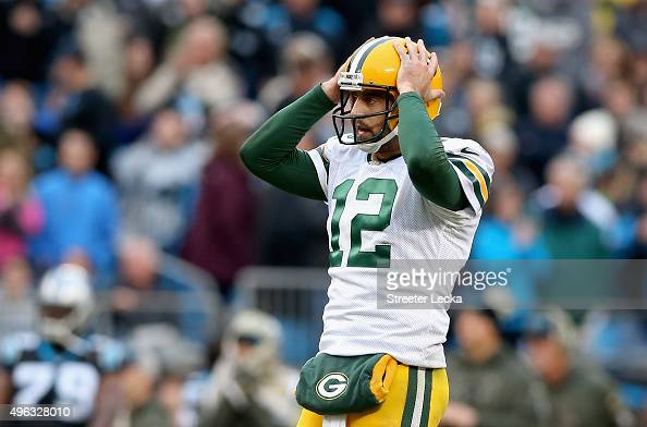 Aaron Rodgers of the Green Bay Packers reacts after a pass during their game against the Carolina Panthers at Bank of America Stadium on November 8...