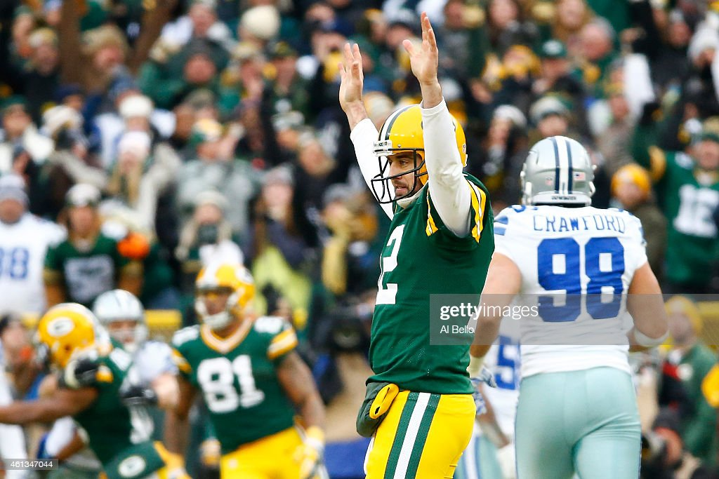Aaron Rodgers #12 of the Green Bay Packers reacts after completing a pass against the Dallas Cowboys during the 2015 NFC Divisional Playoff game at Lambeau Field on January 11, 2015 in Green Bay, Wisconsin. The Packers defeated the Cowboys 26-21.