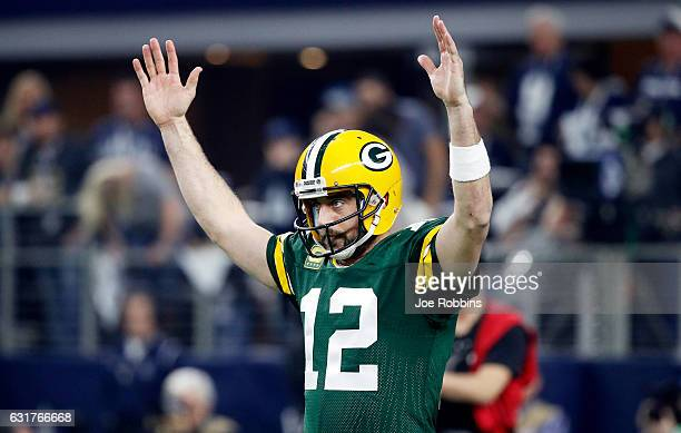 Aaron Rodgers of the Green Bay Packers reacts after scoring a touchdown in the first half during the NFC Divisional Playoff Game against the Dallas...