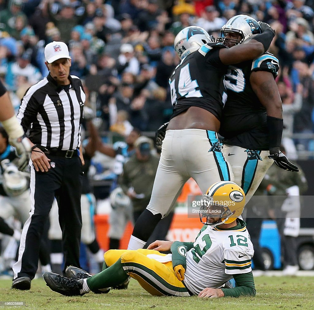 Aaron Rodgers of the Green Bay Packers reacts after the Carolina Panthers make a defensive stop at Bank of America Stadium on November 8 2015 in...