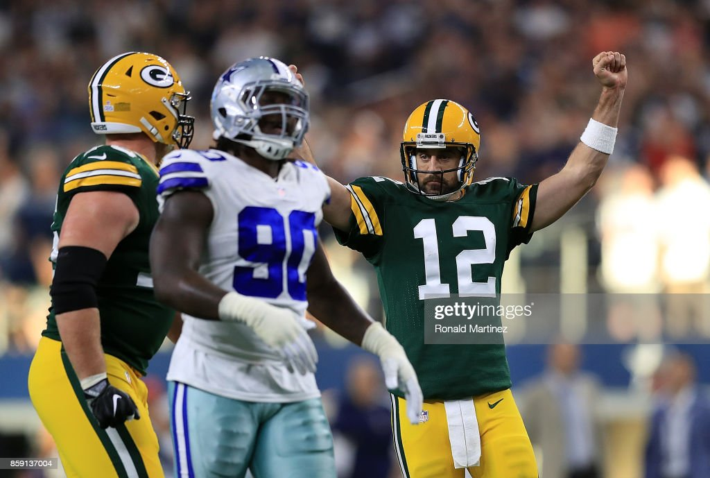 Aaron Rodgers #12 of the Green Bay Packers reacts after throwing the game winning touchdown against the Dallas Cowboys in the fourth quarter at AT&T Stadium on October 8, 2017 in Arlington, Texas.
