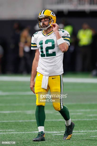 Aaron Rodgers of the Green Bay Packers reacts during the first half against the Atlanta Falcons at MercedesBenz Stadium on September 17 2017 in...