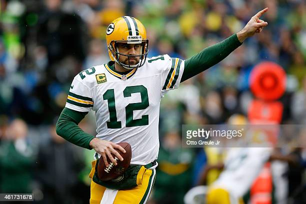Aaron Rodgers of the Green Bay Packers reacts in the first quarter against the Seattle Seahawks during the 2015 NFC Championship game at CenturyLink...