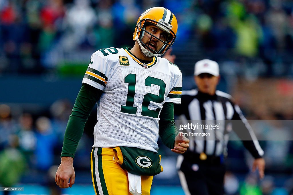<a gi-track='captionPersonalityLinkClicked' href=/galleries/search?phrase=Aaron+Rodgers+-+Football+americano+-+Quarterback&family=editorial&specificpeople=215257 ng-click='$event.stopPropagation()'>Aaron Rodgers</a> #12 of the Green Bay Packers reacts in the fourth quarter against the Seattle Seahawks during the 2015 NFC Championship game at CenturyLink Field on January 18, 2015 in Seattle, Washington.