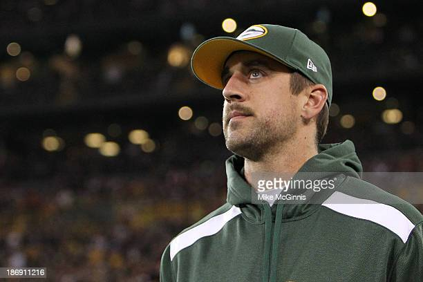 Aaron Rodgers of the Green Bay Packers returns to the field after a colar bone injury which occurred in the first half of the game against the...