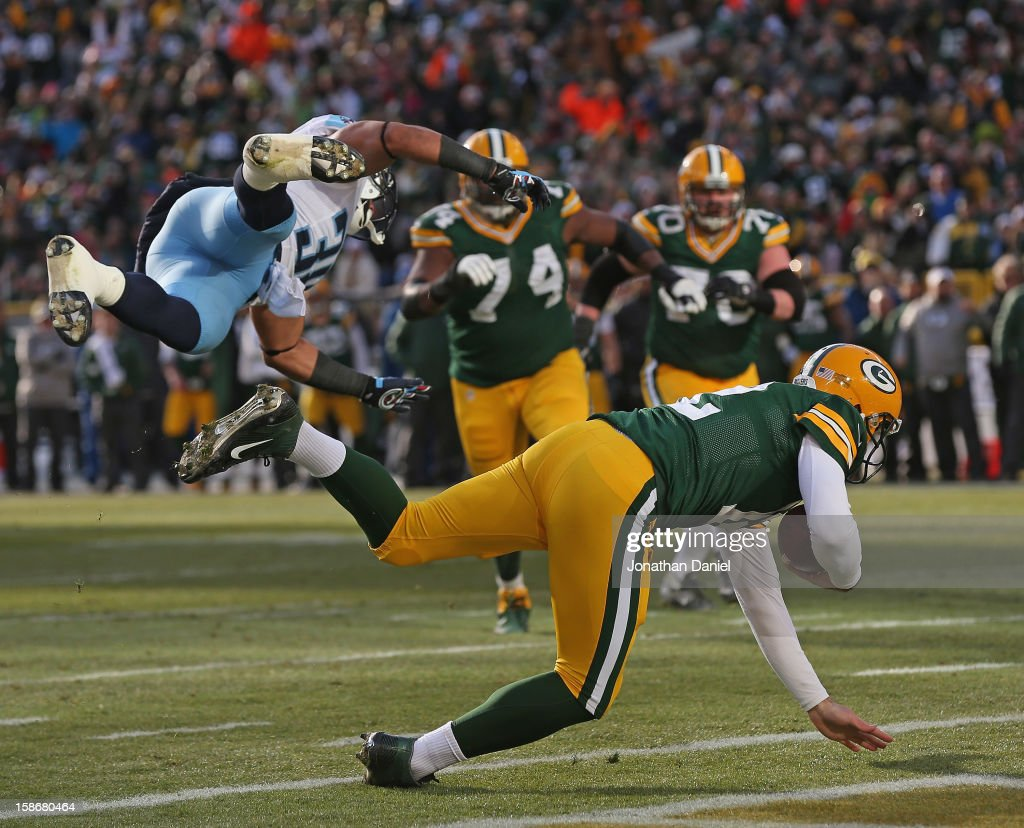 <a gi-track='captionPersonalityLinkClicked' href=/galleries/search?phrase=Aaron+Rodgers+-+American+Football+Quarterback&family=editorial&specificpeople=215257 ng-click='$event.stopPropagation()'>Aaron Rodgers</a> #12 of the Green Bay Packers rolls inot the end zone for a score after being grazed by Al Afalava #38 of the Tennessee Titans at Lambeau Field on December 23, 2012 in Green Bay, Wisconsin.