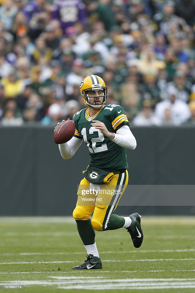 Aaron Rodgers #12 of the Green Bay Packers rolls out looking for a receiver during a game against the Minnesota Vikings at Lambeau Field on December 2, 2012 in Green Bay, Wisconsin. The Packers defeated the Vikings 23-14.