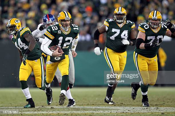 Aaron Rodgers of the Green Bay Packers runs the ball against the New York Giants during their NFC Divisional playoff game at Lambeau Field on January...