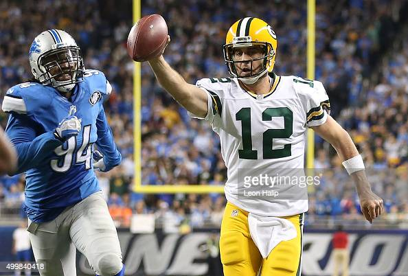 Aaron Rodgers of the Green Bay Packers runs the ball for a fourth quarter touchdown against the Detroit Lions on December 3 2015 at Ford Field in...