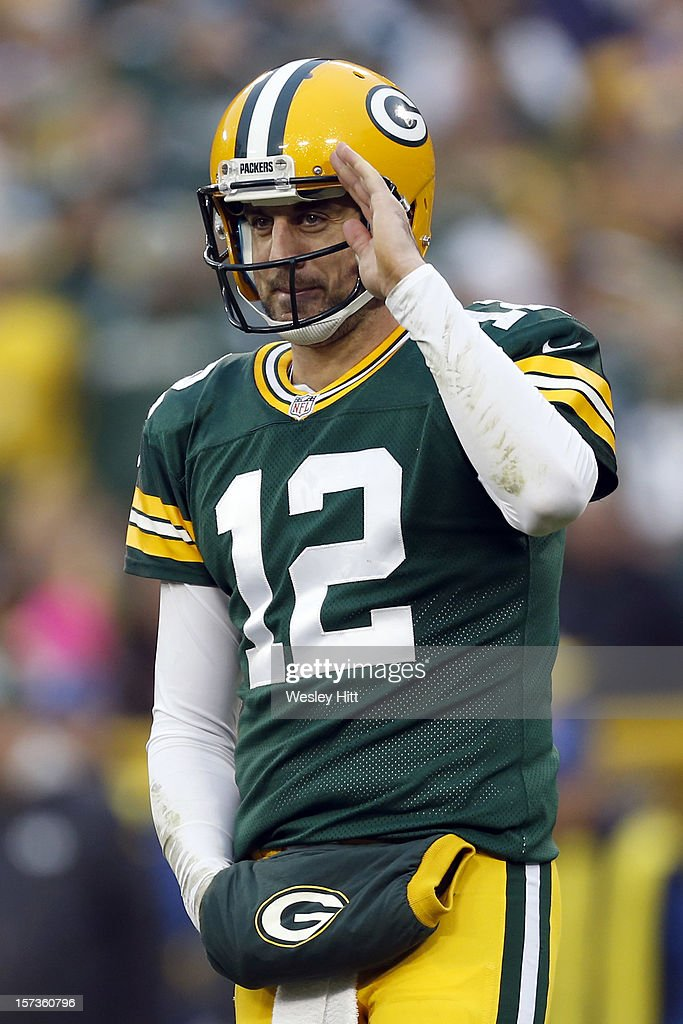 Aaron Rodgers #12 of the Green Bay Packers salutes to the Minnesota Vikings sidelines during a game at Lambeau Field on December 2, 2012 in Green Bay, Wisconsin. The Packers defeated the Vikings 23-14.